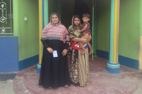 Jahangir Alam's mother (left) and wife, Rehana Akhter, outside the family house from where he was taken away by police