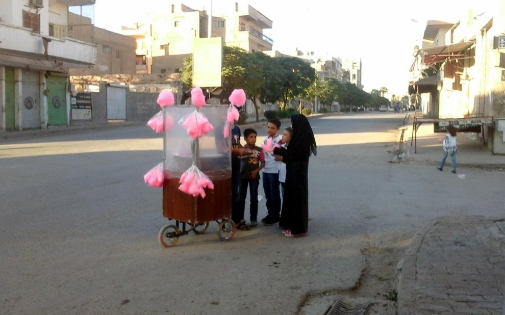 Syrian children buy cotton candy in Raqqa on Oct. 8, 2014.