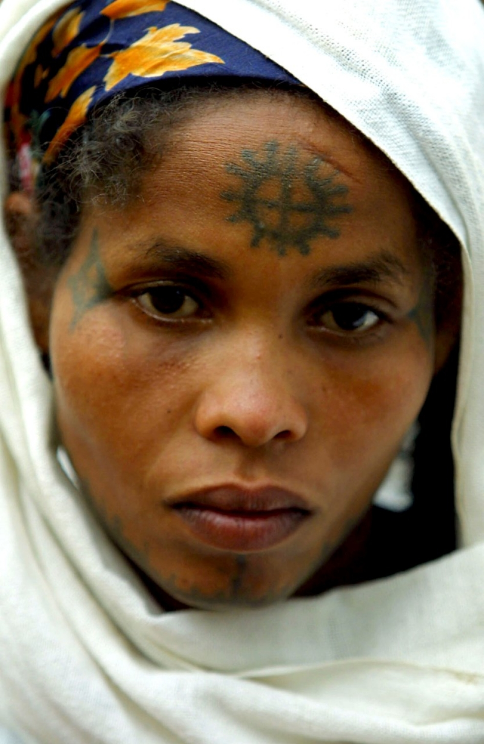 A Jewish Ethiopian woman with a cross tattooed on her forehead poses for a portrait on March 14, 2003 at the Beta Israel School in Addis Ababa, Ethiopia.