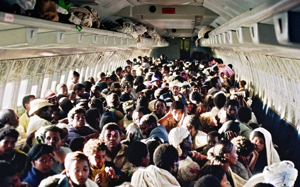 "Ethiopian Jews known as ""Falashas"" sit on board an Israeli Air Force Boeing 707, during their transfer from Addis Ababa to Tel Aviv early in 1991."