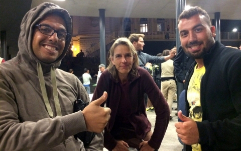 German volunteer Tsamira Weissflug, center, with Amar Saleh, left, and Yasim al-Eriksousi, Syrian refugees from Damascus.