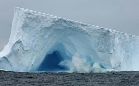 Massive breaking icebergs unexpectedly slow global warming, scientists say