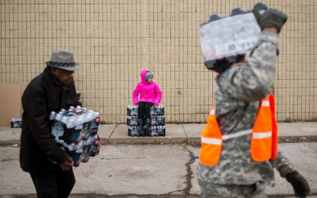 Michigan's emergency manager comes under fire in Flint and Detroit