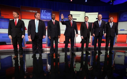 Republicans debate without Trump but still compete with him