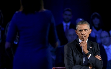 Pushing for gun controls, Obama tears into the NRA