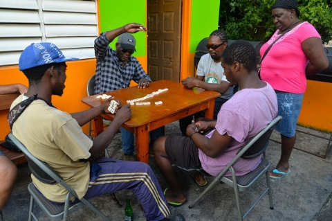 Montserratian men play dominoes on a Friday afternoon.