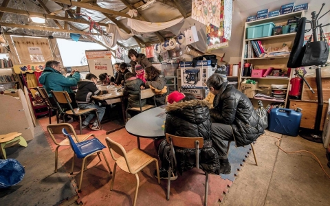 Migrant children attend a lesson in a makeshift school on Feb. 10, 2016, in the so-called Jungle migrant camp in Calais.