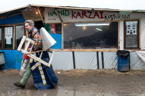 A man walks past a makeshift restaurant on Feb. 23, 2016 in the refugee camp in Calais.