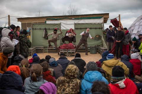 Actors from Shakespeare's Globe perform Hamlet for migrants at the Good Chance Theatre Tent in the Jungle refugee camp on Feb. 3, 2016 in Calais, France.