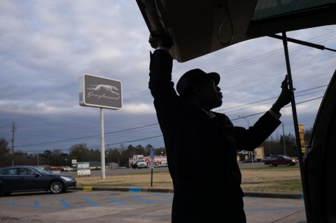 Michael Harris prepares to load a customer's luggage at the Greyhound station on South Boulevard.