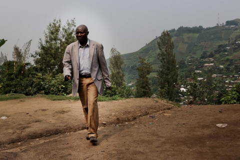 Pastor Shombo walks or takes his motorbike to reach the mountainous communities in South Kivu.