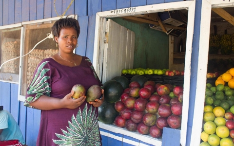 Mukanoheri Mary Chantal, 32, outside her fruit stand in Kigali, Rwanda.