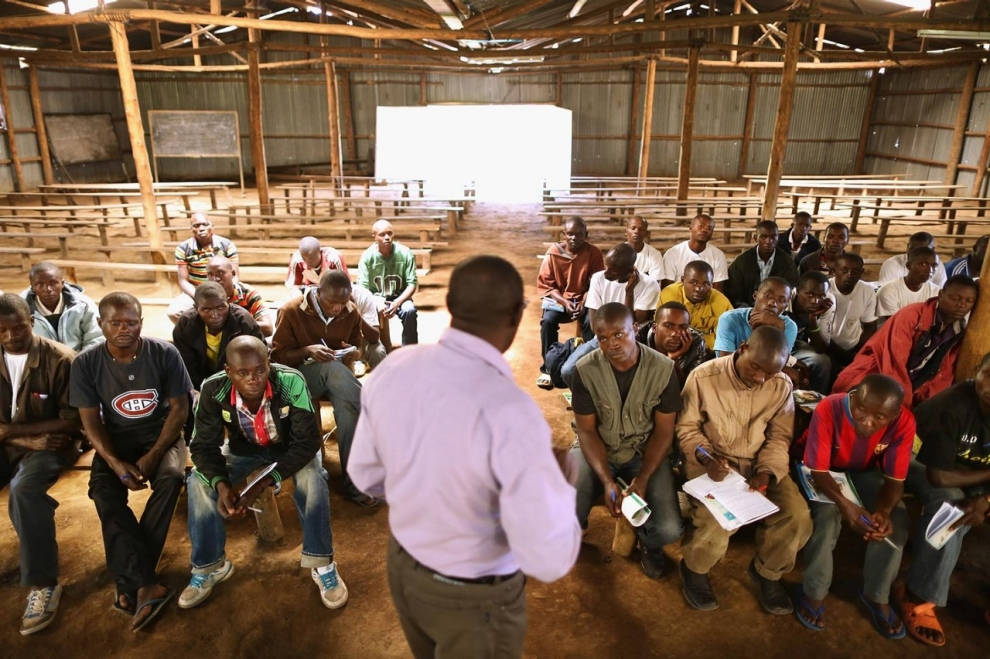 Teacher Alphonse Senyoni leads a class on history, politics and the 1994 genocide for former FDLR)combatants at the Mutobo Demobilisation Centre on April 10, 2014.