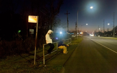 Erica Pendleton, 27, waits at a bus stop on Chef Mentor Highway in New Orleans East on Feb. 10, 2016.