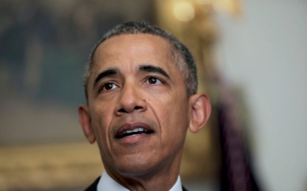 Obama visits US mosque in a bid to speak out against bigotry