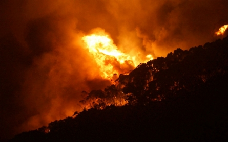 Raging Australian bushfire destroys more than 100 homes