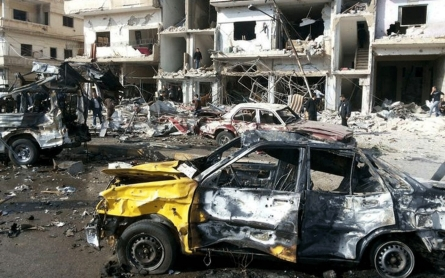 Syria war: Blasts kill 129 in Damascus and Homs