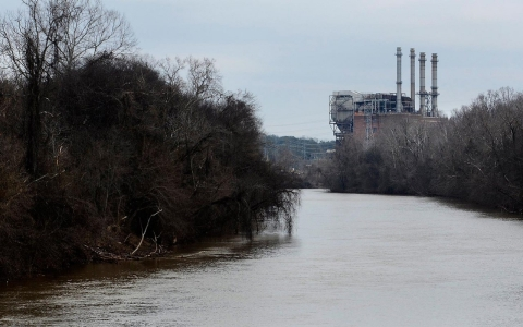 The Dan River flows downriver toward the decommissioned Duke Energy coal fired steam station in Eden, N.C.