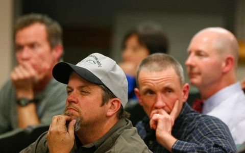 Citizens listen as representatives from the EPA and Duke Energy speak at a town gathering in Eden on Feb. 19.