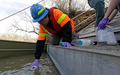 Didi Fung, a contractor for the Environmental Protection Agency, collects water samples from the Dan River as state and federal environmental officials continued their investigations of the spill in North Carolina.