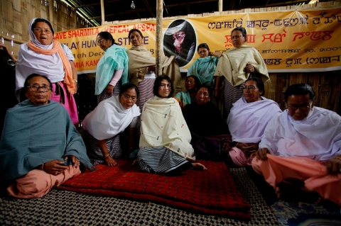 March 10, 2011 — Irom Sharmila, center, leans against the pole in a hut outside Nehru Hospital in Imphal, surrounded by supporters.