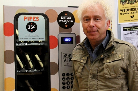 A crack pipe vending machine and Mark Townsend, co-executive director of the Portland Hotel Society