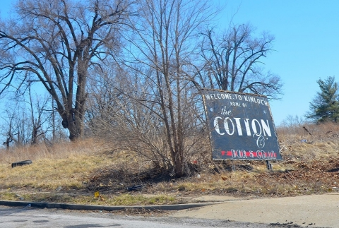 A sign advertises the now-defunct Cotton Club in Kinloch.