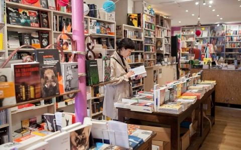 Customer Yeonmi Park browses books inside Page 189, located in the 11th. Park came in looking for Korean literature, and is a neighborhood local.