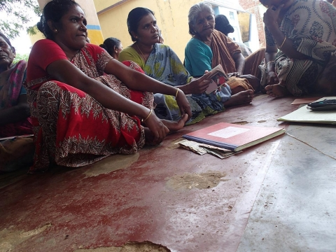 M. Papa Madasamy and her fellow Women's Collective chapter members go over the books of their loan funds.