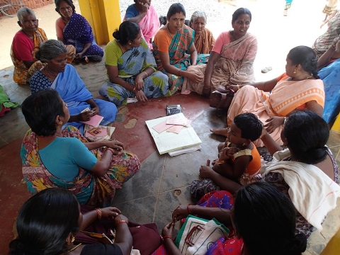Tamil Nadu Women's Collective members in the village of T.N. Puthukudi at a monthly meeting at their neighborhood temple.