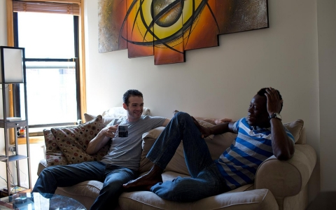 Rodrigue, a gay West African immigrant, and his boyirend, Jesse, in Rod's apartment in Harlem.