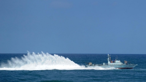 A Sri Lankan navy boat takes part in a Victory Day parade rehearsal in Colombo on May 15, 2012.