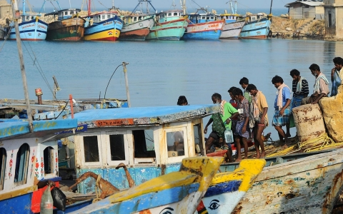 Indian fishermen walk on vessels after they were freed by a local Sri Lankan court at Katchchativu in Jaffna District on March 17, 2014.