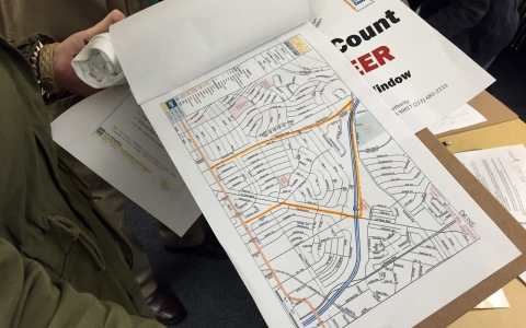 On the second night of the 2015 Los Angeles homeless count, volunteer Leah Hubbard examines her assigned area.