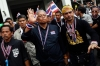 Protest leader and former Deputy Prime Minister Suthep Thaugsuban, center, waves to protesters at the Finance Ministry.