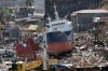 A cargo ship lies amid the wreckage in Tacloban's Anibong district.