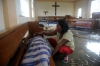 A mother weeps beside the body of her son at a chapel in Tacloban on Saturday.