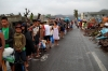 Residents affected by the tragedy wait in line for relief goods in Leyte.