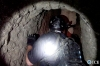 A Homeland Security agent on Thursday enters a tunnel used to smuggle drugs between the U.S. and Mexico.