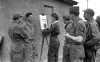 An American Red Cross photo shows Black sketching troops in England in 1944.