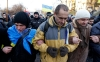 Protesters link arms as they make their way to Independence Square in Kiev Tuesday.