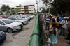 Cubans line up to buy used cars at a government-owned dealership in Havana on Jan. 3, 2014.