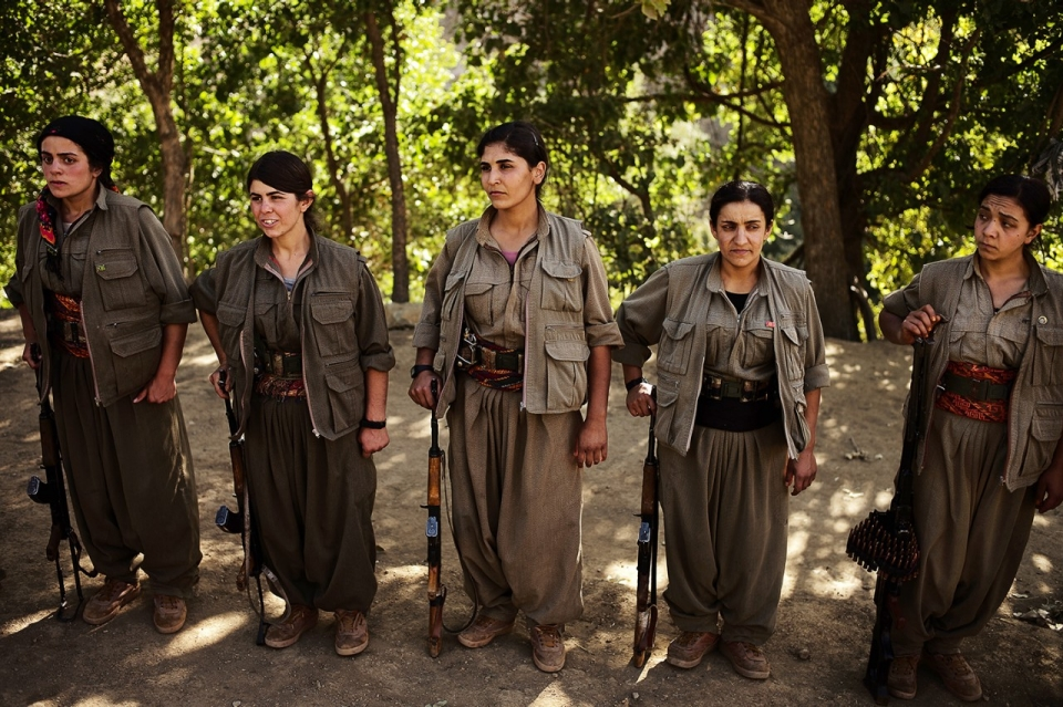 Group of female fighters take a break from training to play 7