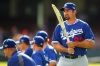 Adrian Gonzalez of the Dodgers holds a cricket bat.
