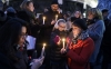 People like candles during a rally in support of the victims of the attack by gunmen at French satyrical newspaper Charlie Hebdo at the Place de la Republique.