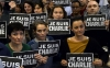 "Journalists hold placard reading ""I am Charlie"" as they hold a minute of silence, on January 7, 2015 at the redaction of French news agency Agence France Presse."