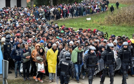 Photos: Refugees flood into Slovenia