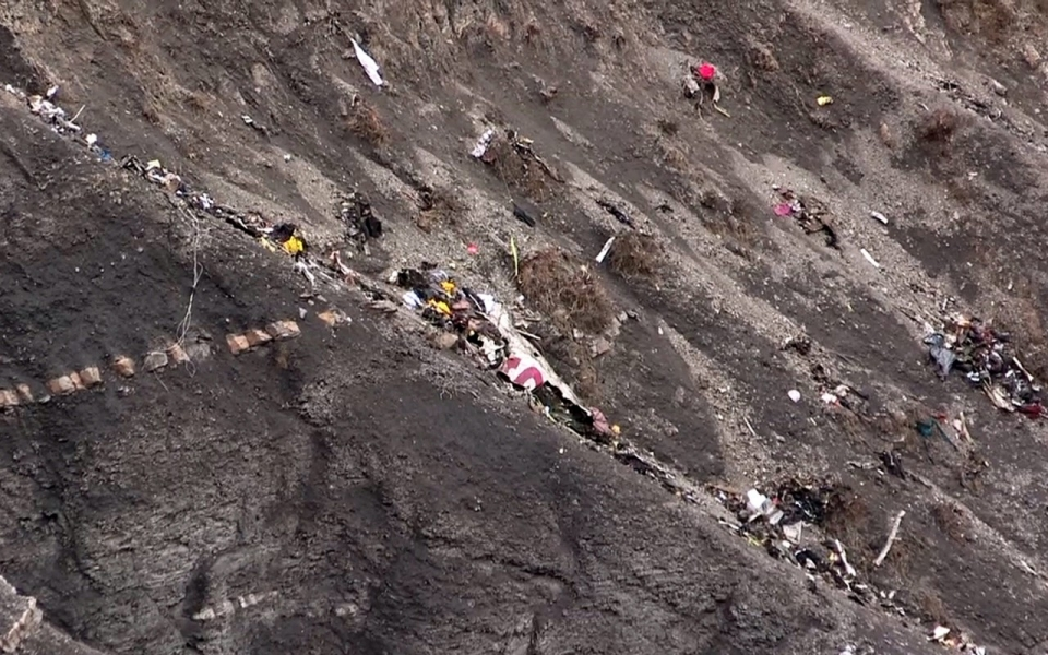 on March 24, 2015 shows debris at the crash site of a Germanwings ...