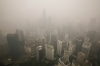 Buildings are shrouded by haze in Kuala Lumpur, Malaysia Monday, Sept. 14, 2015.