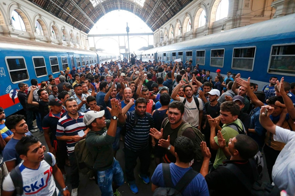 http://america.aljazeera.com/content/ajam/multimedia/photo-gallery/2015/9/photos-hungary-closes-train-station-to-stem-flow-of-refugees/_jcr_content/slideShowImages/slide2/image.adapt.960.high.hungary_refugees_station_02a.jpg